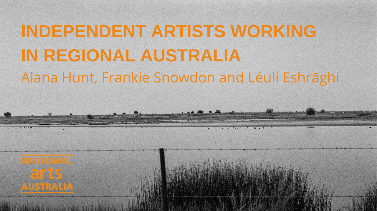 "Black and white photo of a lake with land in the background with some plants.  In front is a wire fence.  Text on photo says ""Independent Artists working in Regional Australia. Alana Hunt, Frankie Snowdon and Leuli Eshraghi.  Regional Arts Australia."