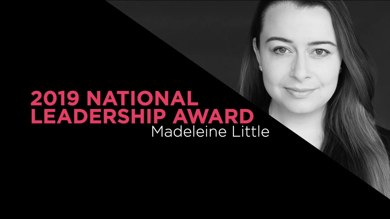 A black and white photo of a young woman with long straight black hair and smile.  Words on photo say 2019 National Leadership Award Madeleine Little